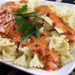 Vodka Pasta a la Guido Recipe - Penne with a rich, spicy pink sauce. Save it for special occasions. Your family or friends will think you slaved for hours to create it. Increase or decrease the red pepper flakes to your taste.