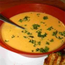Butternut and Acorn Squash Soup Recipe - This is a rich and sweet yet surprisingly simple soup that is wonderful served hot with crusty bread or cold with a dollop of sour cream.
