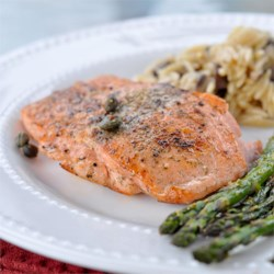 Pan Seared Salmon I Recipe - Simply seasoned with salt and pepper, these salmon fillets are pan seared with capers, and garnished with slices of lemon.