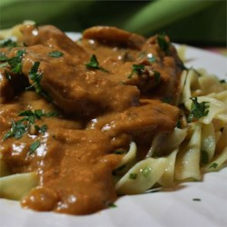 Nana's Beef Stroganoff Recipe - A traditional beef and mushroom Stroganoff with a touch of tomato and white wine is finished with sour cream for a great skillet dish to serve over rice or egg noodles.