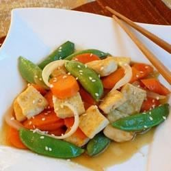 Tofu Vegetable Stir Fry Recipe - The dipping sauce for our Sake Shrimp Skewers doubles as a sauce in this light and fragrant tofu and vegetable stir fry. Reserve the sesame seeds and cilantro for garnish if desired. Serve as an entrée or side dish.