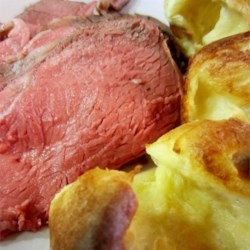 Kim's Prime Rib Recipe - The garlic,  and soy sauce, and Worcestershire flavored sauce for this roast is literally injected with a turkey baster. Recipe may be halved or doubled.