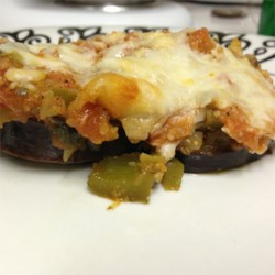 Cheesy Baked Eggplant Recipe - This is a very cheesy and easy to make baked eggplant dish with an Italian flair. An excellent alternative to a pasta dish.