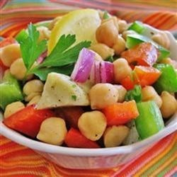 Garbanzo Bean and Pepper Salad Recipe - I made up this recipe for a cool summer dish to take to a picnic. I just threw together things I had on hand and it became a hit! You may substitute your favorite type of bean for the garbanzos. Any firm bean will do. You may omit the jalapeno altogether. This salad will work as a main course and is very satisfying and colorful. The different tastes and textures are very pleasing. Serve cold.