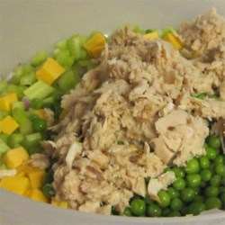 Grandma Wells' Tuna Macaroni Salad Recipe - A vintage recipe for delicious macaroni salad has albacore tuna, chunks of Cheddar cheese, and green sweet peas in a simple mayonnaise dressing. Just mix, chill, and serve.