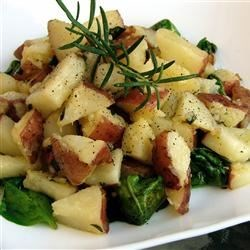 Emily's Famous Fried Potatoes Recipe - This is a very tasty potato recipe that is also great for using up leftover baked potatoes. The vinegar gives the spinach a sweet flavor.