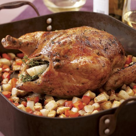 Whole Roasted Lemon-Herb Chicken on a Bed of Vegetables
