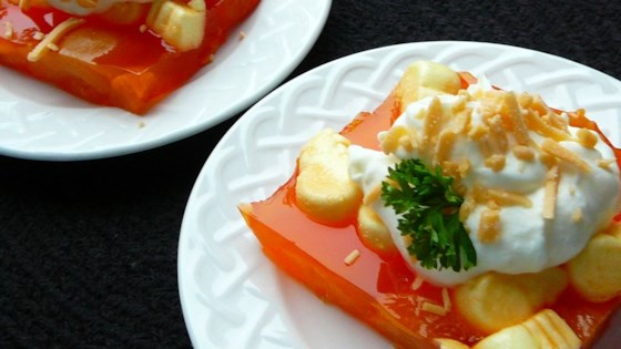 Apricot jello salad with cooked topping