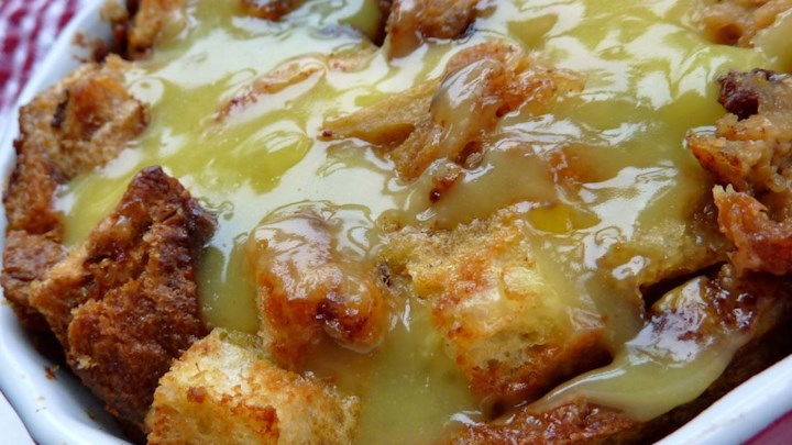 Rum Raisin Bread Pudding with Warm Vanilla Sauce