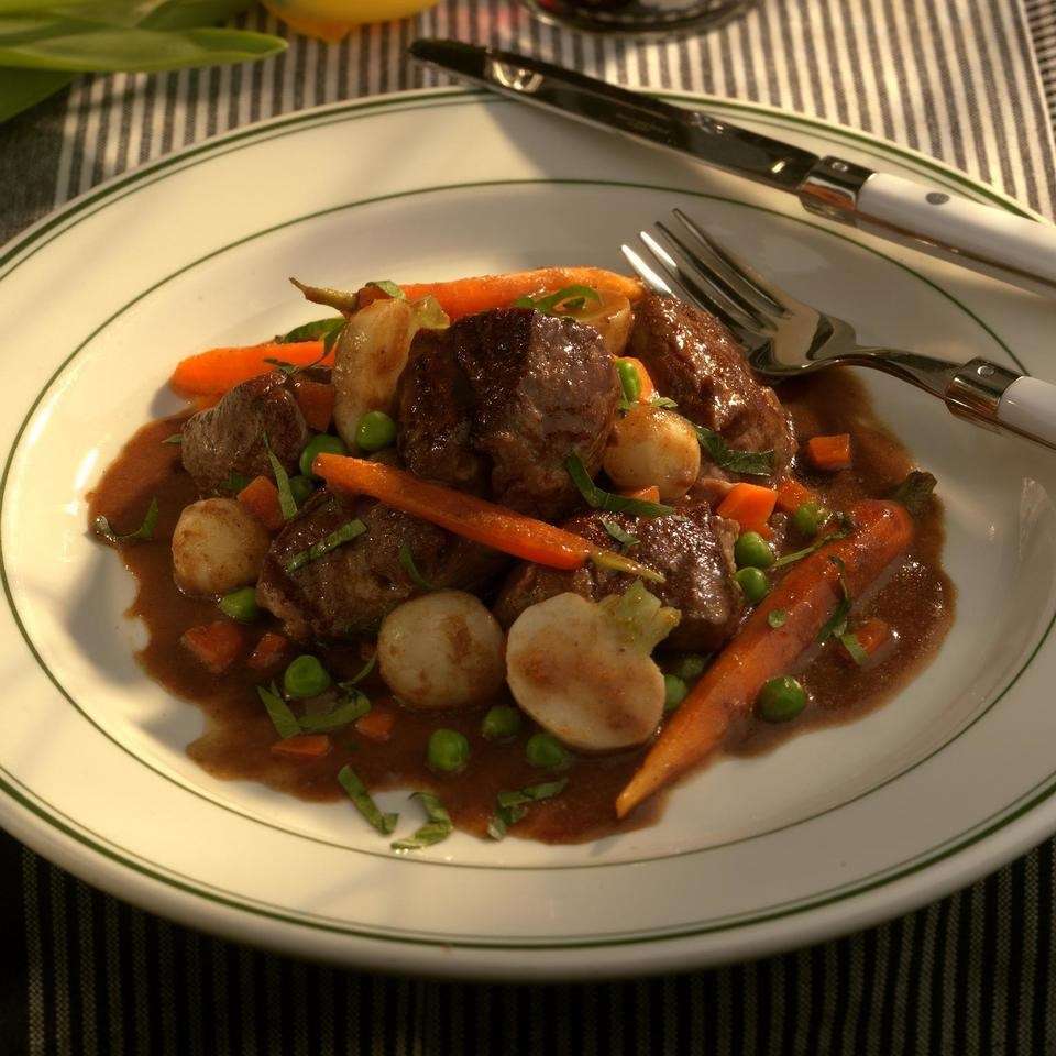 braised lamb with a garden vegetable medley recipe eatingwell
