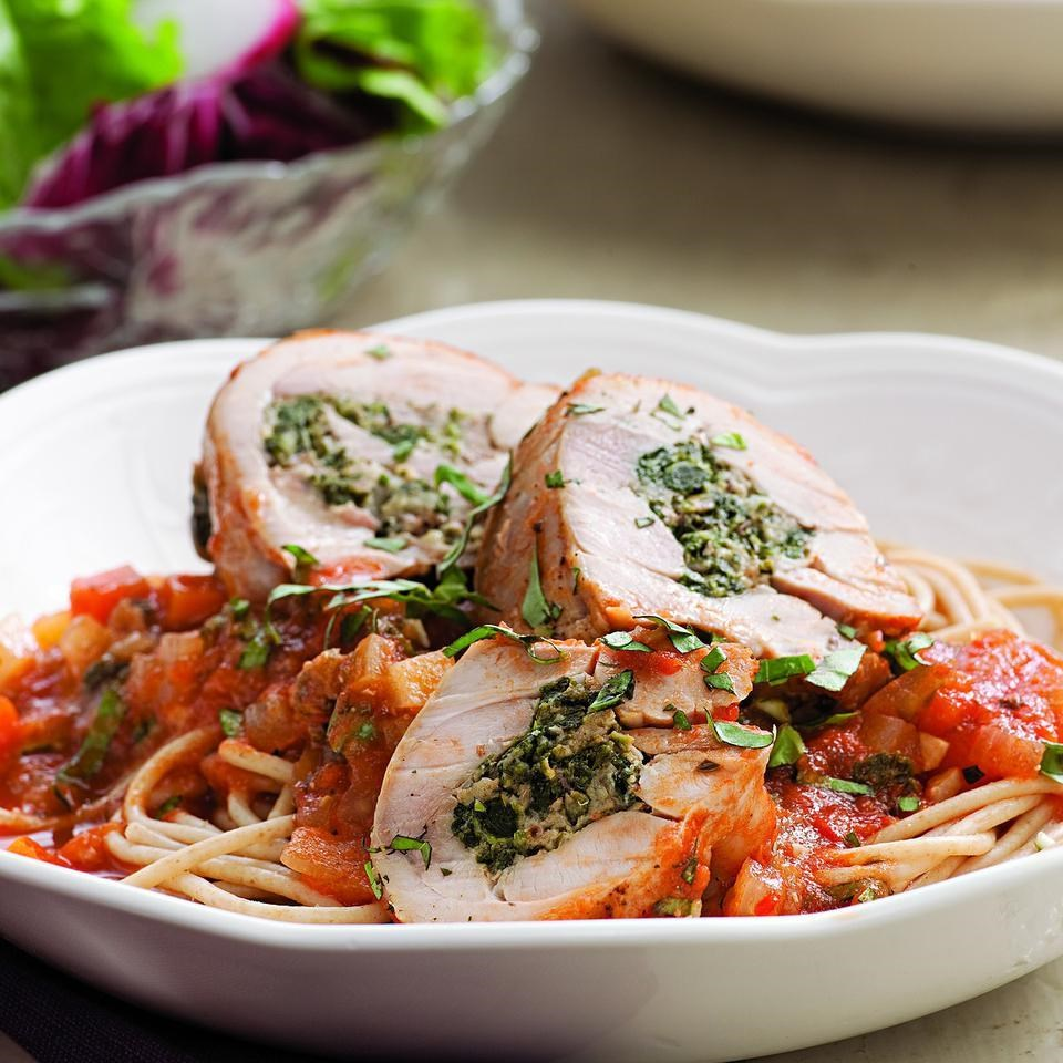 Stuffed Chicken Thighs Braised in Tomato Sauce Recipe - EatingWell.com