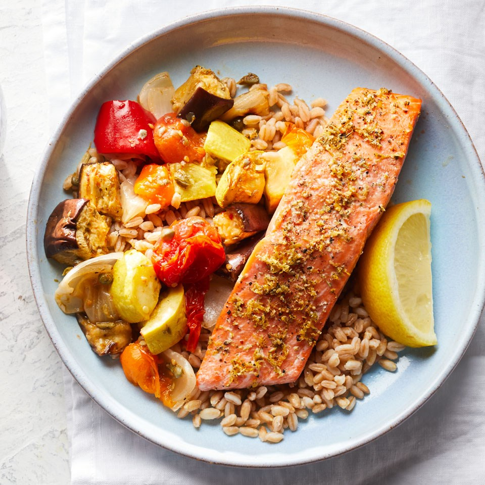 lemon-herb salmon with caponata and farro on a plate