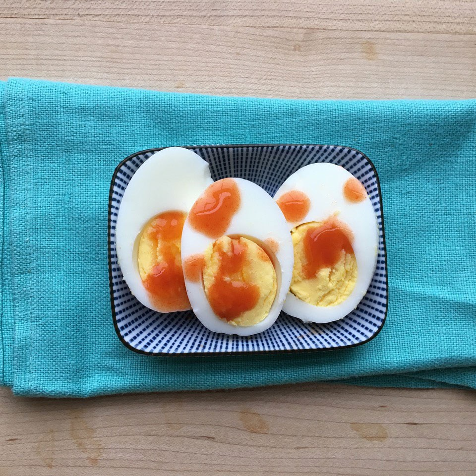 Hard-Boiled Egg with Hot Sauce