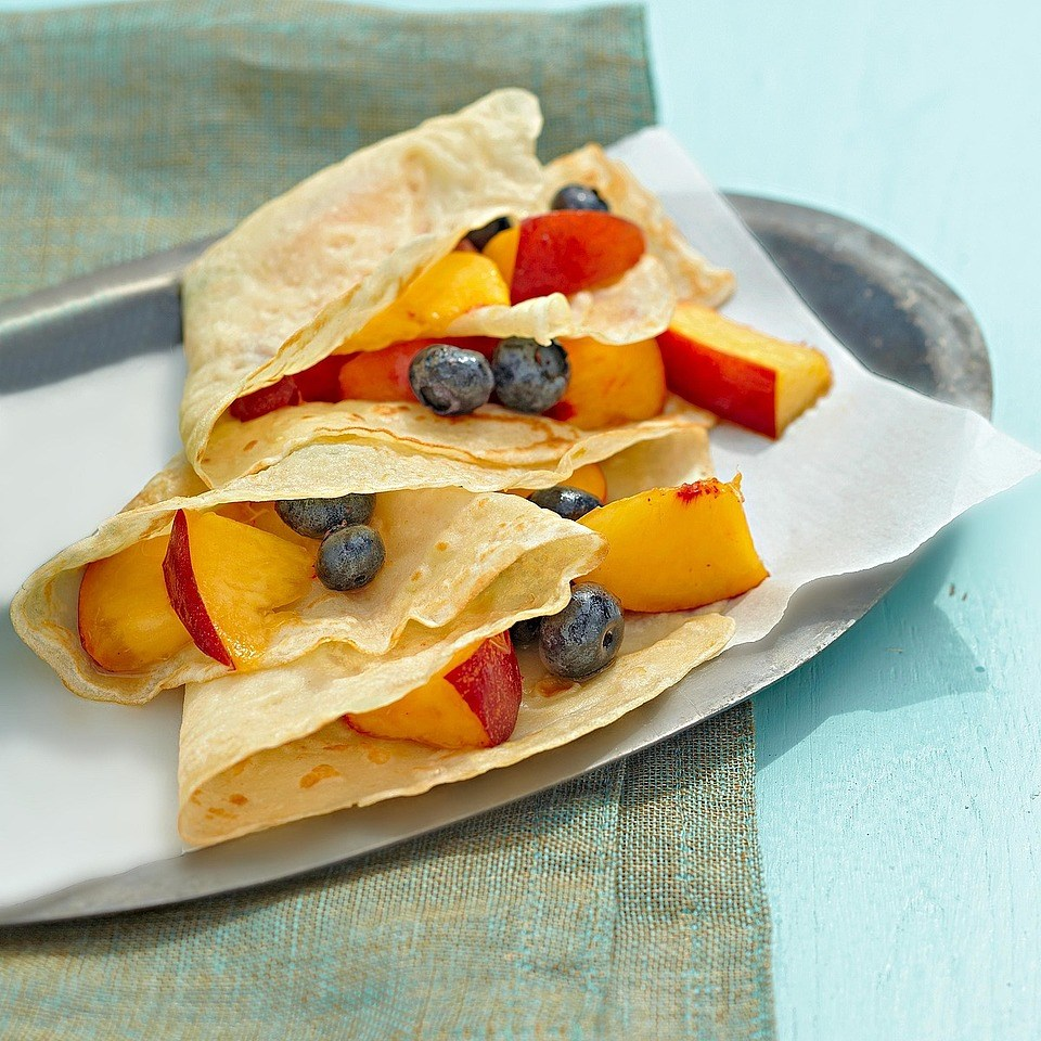 Lemon-Scented Crepes with Honeyed Fruit