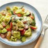 Pesto Primavera Tortellini with Chicken Recipe - Colorful roasted vegetables are mixed with cheese tortellini, chopped pan-fried chicken breasts, and homemade basil pesto for a complete meal-in-one dish.