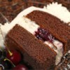 Black Forest Cake I Recipe and Video - This recipe delivers a classic version of the original Black Forest cake with whipped cream frosting and cherry toping.