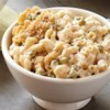 The Ultimate Macaroni, Cheese and Peas Recipe - Three kinds of cheese plus sweet peas make this mac and cheese a delicious one-dish weeknight dinner.