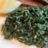 Fast and Easy Creamed Spinach Recipe and Video - Fresh spinach is cooked in a light cream sauce flavored with shallots, lemon, and a little nutmeg for a side dish that's perfect with any main dish.