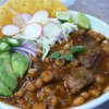 Slow-Cooker Posole Recipe and Video - Made in a slow cooker, this streamlined version of classic Mexican Posole combines traditional ingredients such as hominy, green chiles, garlic, onions, oregano, and enchilada sauce with cubed pork.