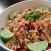 Cranberry and Cilantro Quinoa Salad Recipe and Video - Quinoa is tossed with toasted almonds, dried cranberries, bell peppers, curry powder, and fresh cilantro in this tasty salad.