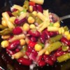 Best Bean Salad Recipe - Five cans of beans are mixed with bell pepper, onion, and celery and tossed in a simple dressing for a delicious marinated bean salad.