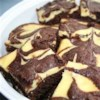 Cheesecake Brownies Recipe - Jazz up an out-of-the-box brownie mix with an easy cheesecake topping.
