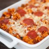 Pizza Pasta Bake with Sausage Recipe - This versatile one-dish pasta bake uses your favorite pizza ingredients like bell pepper, sausage, pepperoni, and olives--and you can use your family's favorite pasta shapes.