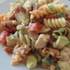 Chicken Club Pasta Salad Recipe and Video - All the fixings for a chicken club sandwich are folded together with pasta and a creamy Italian dressing for a quick and easy lunch.