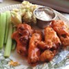 Baked Buffalo Wings Recipe and Video - These easy to make hot wings are crispy without being fried. You can add more cayenne or use a higher hot sauce to butter ratio if you like them spicier!