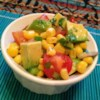 Corn Salad with Lime Vinaigrette Recipe - This summer picnic-salad recipe mixes corn, tomato, and avocado in a simple lime dressing for a delicious side dish or dip for chips.