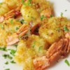 Baked Shrimp Scampi Recipe - Tender shrimp are tossed with butter, garlic, and lemon juice and baked with Italian-seasoned bread crumbs in this rich and flavorful dish.