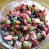 Fruit Salad in Seconds Recipe - Fresh strawberries, grapes, and bananas are folded into cool, refreshing strawberry yogurt.  Delicious!