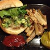 Chipotle Burgers with Avocado Salsa Recipe - Delicious spicy-hot hamburgers seasoned with lots of smoky chipotle peppers are grilled and served on onion rolls with fresh avocado salsa.