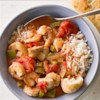 Slow Cooker Chicken Gumbo with Shrimp Recipe - This Cajun-inspired dish practically makes itself. Just dump the ingredients in the slow cooker, toss in the shrimp a few minutes before serving and voila! Dinner is served.