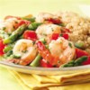 Lemon-Garlic Shrimp & Vegetables Recipe - Here's a healthy twist on shrimp scampi: we left out the butter and loaded the dish up with red peppers and asparagus to create an ample and satisfying portion.