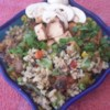 Wild Rice Casserole Recipe - Pork sausage, chicken breast, wild rice and mushrooms flavor this jam-packed meat and rice casserole.