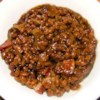 Baked Beans III Recipe - This recipe keeps it sweet and simple.  Baked beans, bacon and brown sugar are all you'll need to make this favorite side dish.