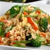 Stir-Fried Rice Recipe - Fried rice in 15 minutes! Cook Minute(R) Rice with chicken broth, stir-fry  vegetables, soy sauce and egg. You'll feel good about serving your family this low- calorie, low-fat dish.