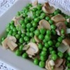 Peas with Mushrooms Recipe - Green peas are sauteed with mushrooms onion and garlic in this quick side dish. These will go well with steak or fish.