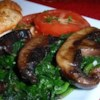 Sauteed Portobellos and Spinach Recipe - Tender portobello mushrooms and spinach are simmered with Parmesan cheese, wine and seasoning. Unique, easy, and extremely tasty side dish!  Excellent with a steak and baked potato dinner.