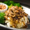 Shredded Apple Pork Recipe - This tender slow cooker pulled pork with apple butter, apple cider vinegar, apples, and Dijon mustard brings the flavors of autumn to the dinner table.