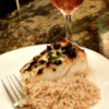 Grilled Sea Bass Recipe - Sea bass is rubbed with seasonings, and grilled in an herbed butter blend.