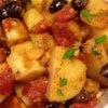 Greek Potato Stew Recipe - Kalamata olives, plump tomatoes, oregano, olive oil and garlic flavor the potatoes in this potato dish. All is turned into a saucepan with the potatoes and simmered until tender and the stew is flavorful. Six servings.