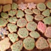 Christmas Tree Cookies Recipe - This is great dessert when you are having company. They are in the shapes of Christmas trees. Use green and red sprinkles and any kind of frosting to decorate.