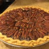 Chocolate Pecan Pie III Recipe - This pie is thick, gooey and full of pecans with just a hint of chocolate. The unsweetened cocoa powder makes the subtle difference.