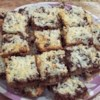 Magic Cookie Bars I Recipe - This recipe makes cookies out of graham crackers, nuts, chocolate chips, and coconut with results to delicious, you'll think it's magic.