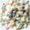 Simple Macaroni Salad Recipe - A crunchy melange of red and green bell peppers, green onions and crispy celery is tossed with macaroni and dressed with a tasty blend of olive oil and mayonnaise flavored with dry soup mix. Chill to finish this festive party salad.