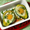 Paleo Baked Eggs in Avocado Recipe - Baked eggs in avocado halves are topped with bacon creating a delicious and satisfying paleo breakfast or snack.