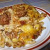 Johnny Marzetti Casserole Recipe - You can't go wrong with these ingredients! A homemade tomato and meat sauce mingles with cheese and pasta and is baked to deliver a delicious meal.