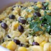 Black Beans, Corn, and Yellow Rice Recipe - Make a meal out of a package of yellow rice by adding black beans, corn, and lime juice.